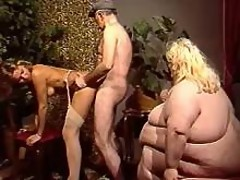 Huge fat woman has fun with freaks in wild orgy