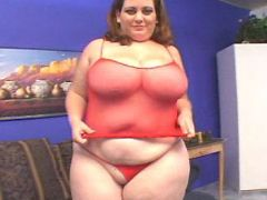 Fat mature in red has fun with guys