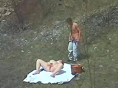 Lusty fatty sucks hard cock of young guy outdoor