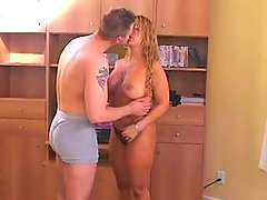 Busty curly blonde enjoys oral sex