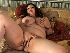 Angel Sin fingers her perfect snatch