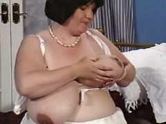 Pregnant mom in lingerie presents huge melons